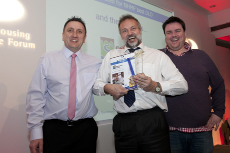 Stockport Homes collect their award for best DLO